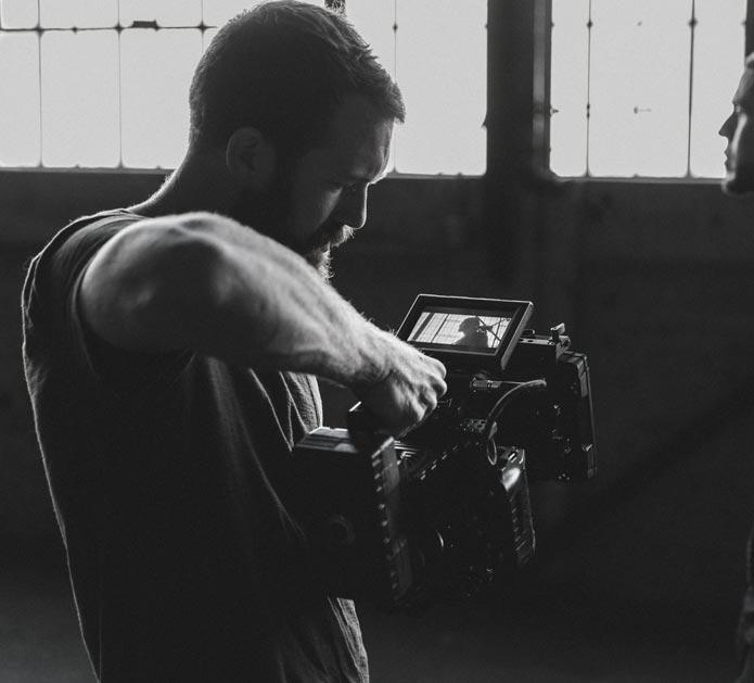 Filmmaker Filming with Camera
